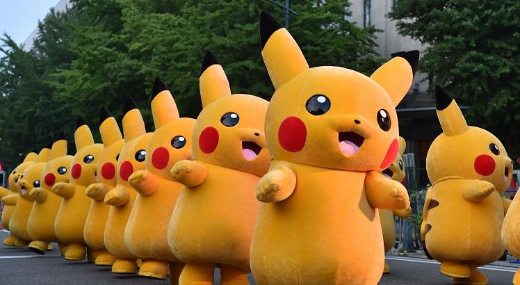 (FILES) This file picture taken on August 2, 2015 shows costumed performers dressed as Pikachu, the popular animation Pokemon series character, attending a promotional event at the Yokohama Dance Parade in Yokohama.  Nintendo shot past Sony in market value on July 19, 2016 after the videogame giant's stock more than doubled since the release of the wildly popular Pokemon Go game.  -   / AFP / KAZUHIRO NOGI